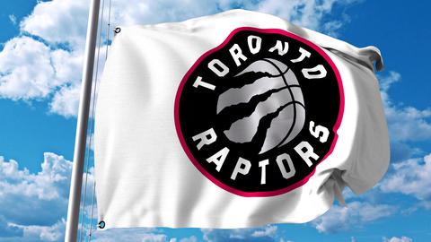 Waving flag with Toronto Raptors professional team logo. 4K editorial clip Live Action