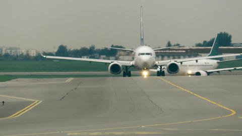 WARSAW, POLAND - SEPTEMBER 8, 2017. Commercial airplanes taxiing at Footage