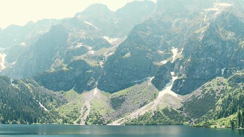 Mountainous lake Morskie Oko or Sea Eye in the Tatra mountains Poland Footage