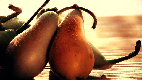 Wet ripe pears on a wooden table Footage