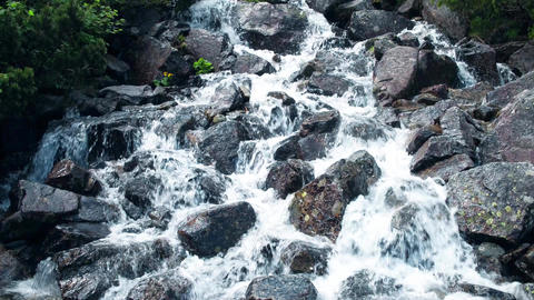 Rushing foamy water of the rocky waterfall Footage