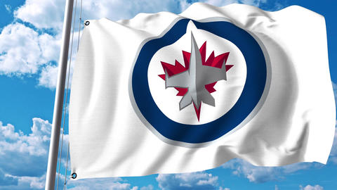 Waving flag with Winnipeg Jets NHL hockey team logo. 4K editorial clip Footage