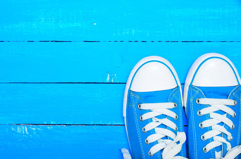 sport textile blue sneakers with white laces Foto