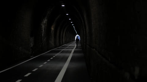 Long tunnel for cyclist and pedestrians with people walking Filmmaterial