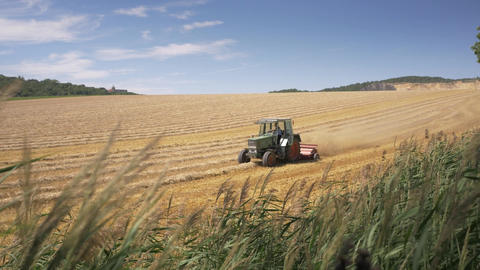 Tractor plowing wheat field after harvest at summer Footage