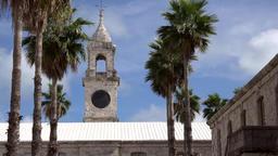 Bermuda Royal Naval Dockyard medium shot of church tower between palm trees Archivo
