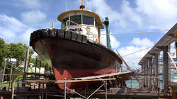Bermuda Royal Naval Dockyard pilot boat in dry dock at the shore Bild