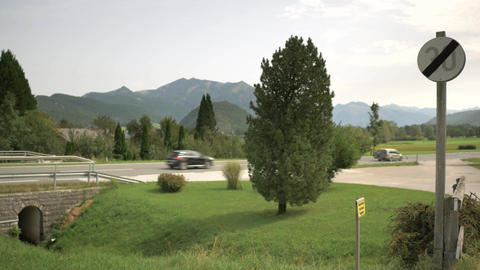 End of speed restrictions sign with beautiful mountains view in Austria Footage