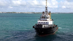 Bermuda Royal Naval Dockyard pilot boat is waiting in turquoise water Archivo