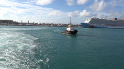 Bermuda Royal Naval Dockyard tail wave with pilot boat and cruise liner Image