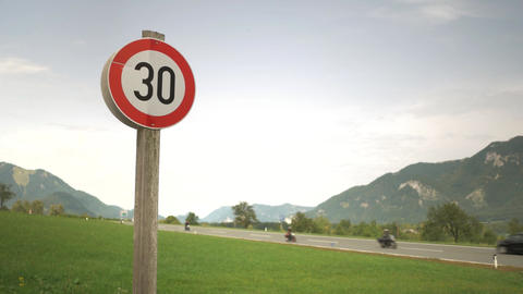 Speed limit 30kmh sign with highway view. Edit sequence Footage