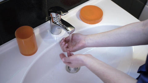 girl washing her hands in the sink Live Action