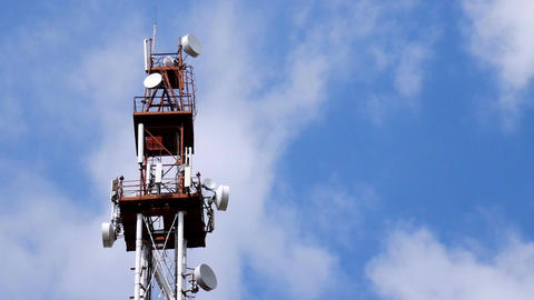 Telecommunication Tower With Repeaters And Antennas Against Blue Sky And White Footage