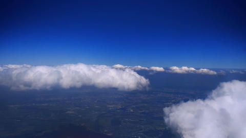 Above Puffy Clouds Image