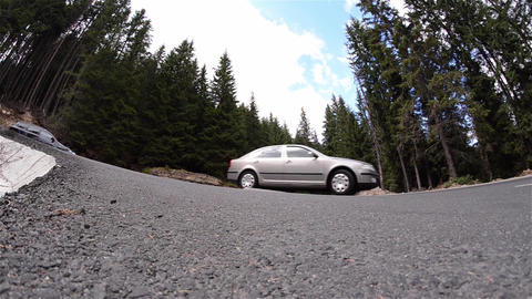 Vehicle traffic on a mountain road in a very tight curve 89 Footage