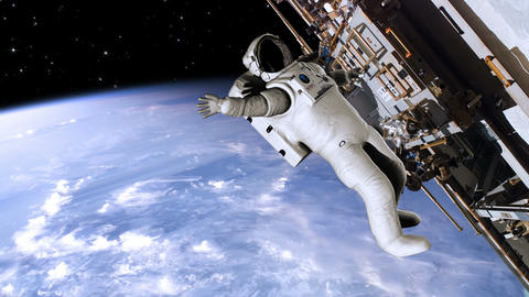 Astronaut working on the international space station - 4K Footage