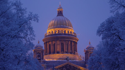 Saint Isaac's Cathedral dome illuminated at night, cold winter Footage