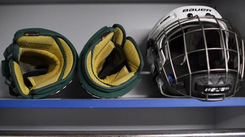 Closeup Hockey Gloves Helmet Lie on Shelf in Locker Room Live Action