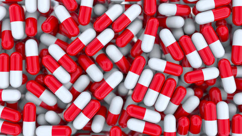 Falling drug capsules or pills, shallow focus. Alpha matte for easy background Footage