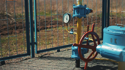 Gas pipe with manometer. Large red shut-off valve. Supply of natural gas to the Footage
