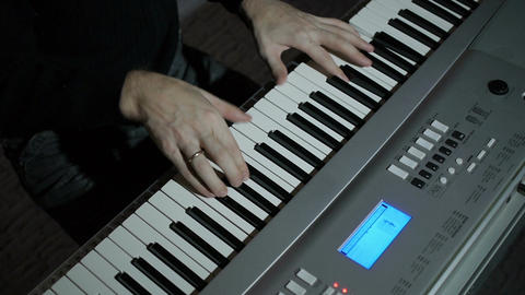 a man playing the piano Footage