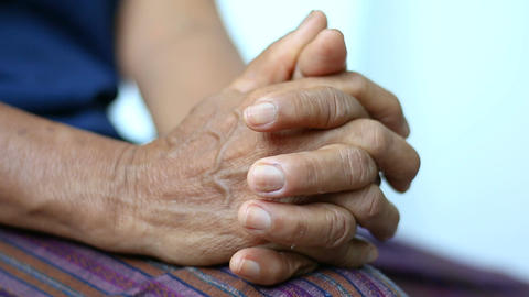 Hands of young woman holding and gentle touch to Hands of old women metaphor and Live Action