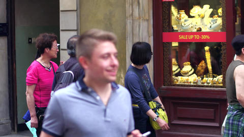 WARSAW, POLAND - JUNE 10, 2017. Asian tourists walk in a traditional jewellery Footage