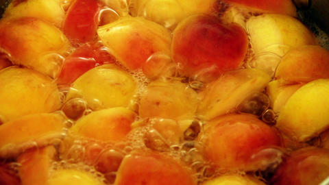 Cooking apple and apricot compote at home Footage