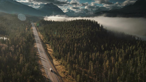 4k 60fps aerial of rv driving on icefields parkway in jasper birds eye Live Action