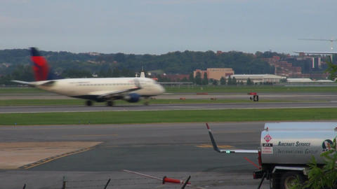 Airplane going down runway at dc airport Live Action
