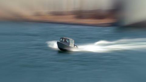 Motorboat zipping across lake blur effect Footage