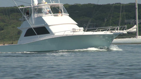 Large fishing boat gliding through inlet closeup Footage