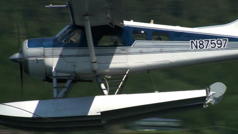 Seaplane flying low across bay Footage