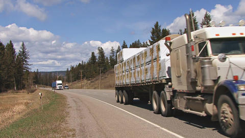 Tractor trailer hauling freight in british columbia Live Action
