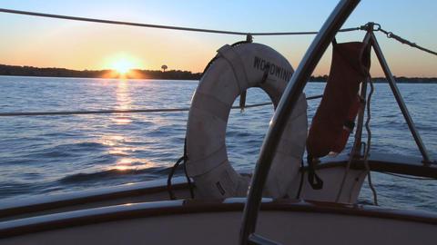 Sailboat lifesaver and sun setting Footage