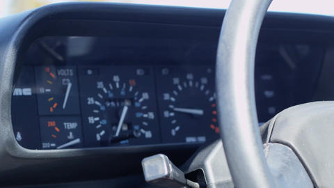 Rack focus of wheel to speedometer in the interior of delorean Footage