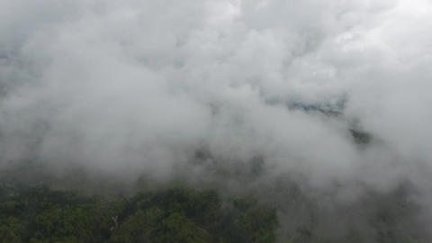 Flying through clouds over lake and mountains Footage