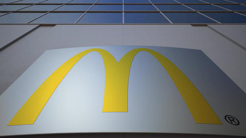 Outdoor signage board with McDonald's logo. Modern office building. Editorial 3D Footage