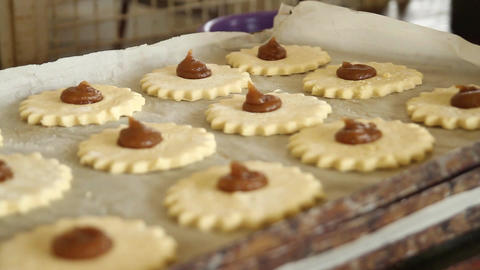 Cookies with jam are cooked in a bakery by hand Footage