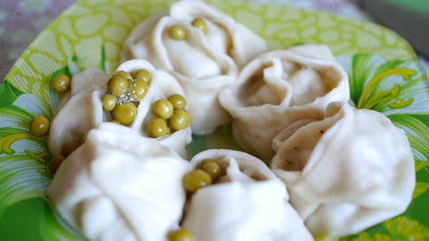 Hot food in a plate with green peas 画像