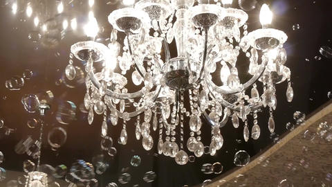 Beautiful hanging crystal chandelier on ceiling Footage