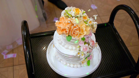 Wedding cake with guests in background at luxury reception Footage