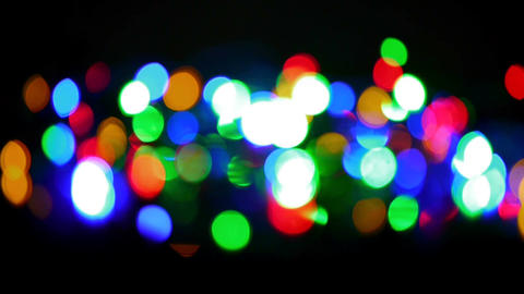 Christmas and new year decoration. Abstract blurred bokeh blinking garland Footage