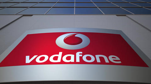Outdoor signage board with Vodafone logo. Modern office building. Editorial 3D Footage