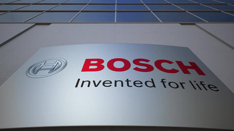 Outdoor signage board with Robert Bosch GmbH logo. Modern office building Live Action