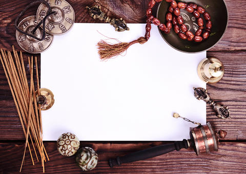 blank white sheet and antique religious objects Foto