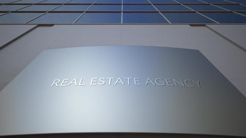Abstract real estate agency signage board on modern office building Live Action