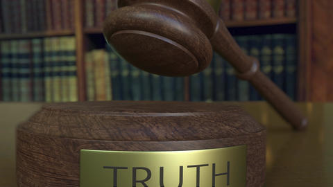 Judge's gavel falling and hitting the block with TRUTH inscription Live Action