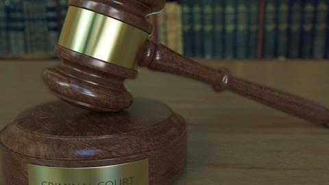 Judge's gavel and block with CRIMINAL COURT inscription Footage