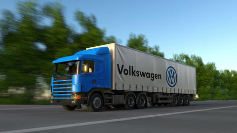Freight semi truck with Volkswagen logo driving along forest road, seamless loop Footage